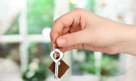 Hand met sleutel